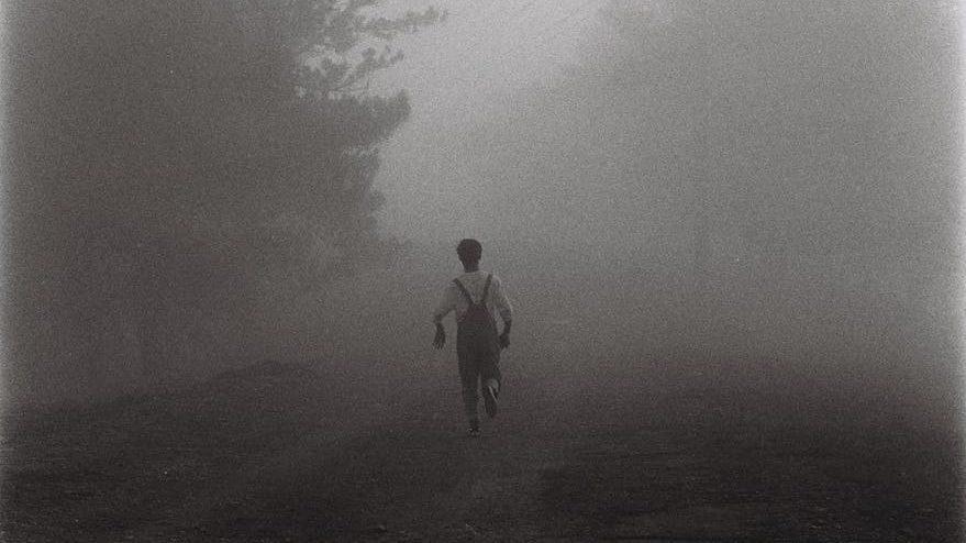 person walking near road