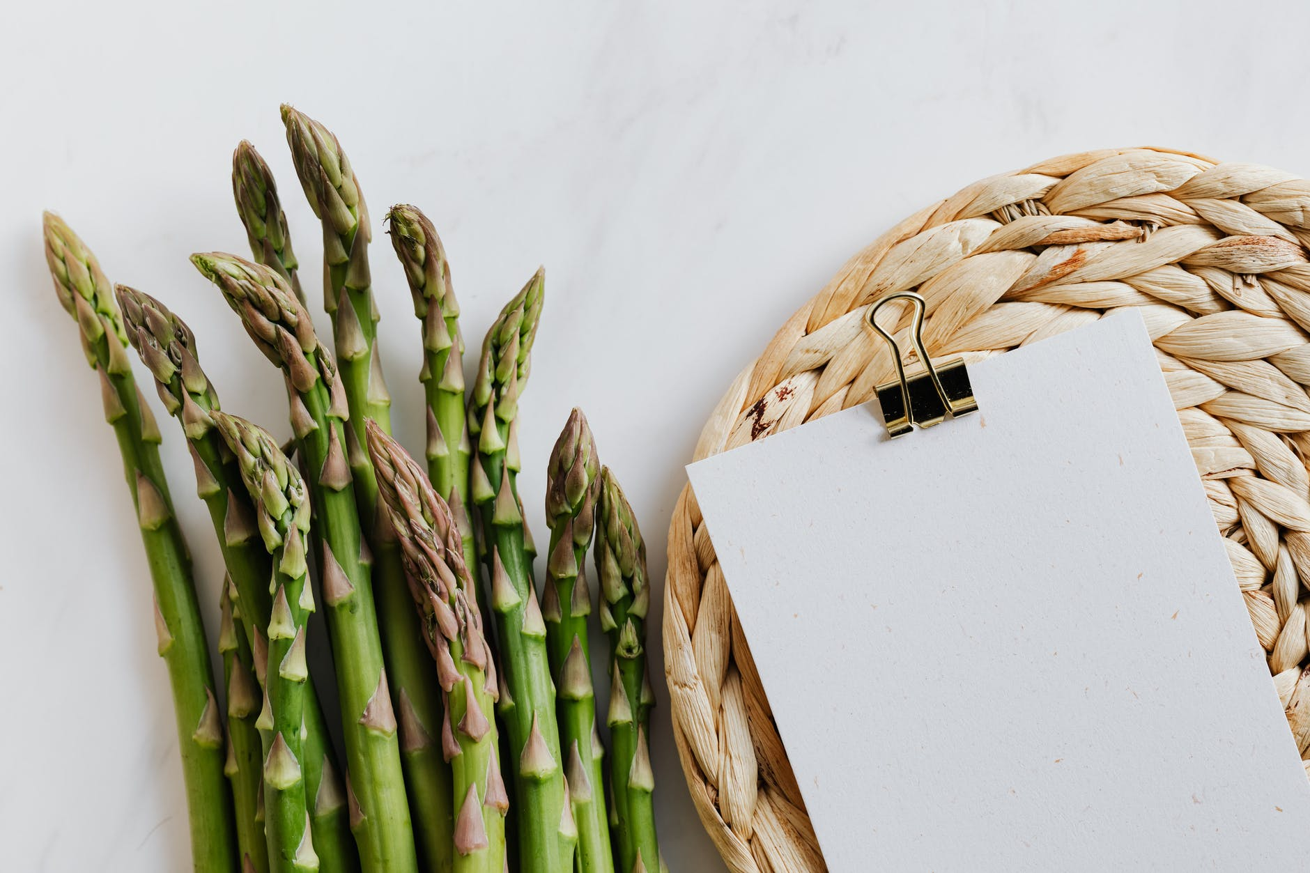 asparagus pods with paper sheet on table