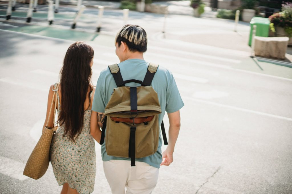 young couple walking together in city district