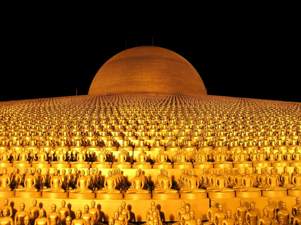 gold colored buddhas dome building