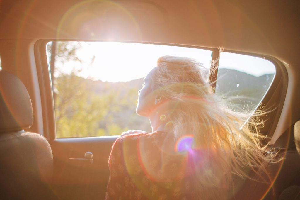 woman looking out of car window
