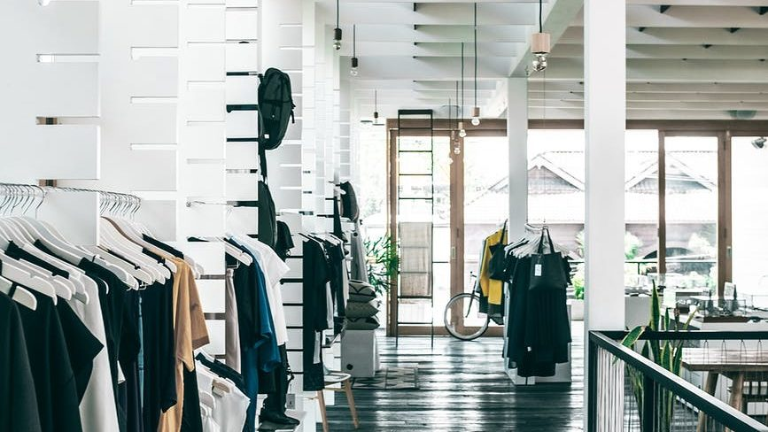 fashion store interior with garments hanging on racks